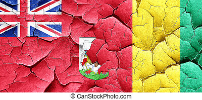 bermuda flag with Guinea flag on a grunge cracked wall
