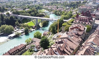Aerial view of details of bridges in Bern old town, Switzerland, UNESCO World Heritage Site since 1983 from Cathedral bell tower. Skyline cityscape of medieval houses and roofs.