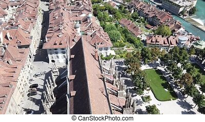 Bern old town, Switzerland, and Aare River with bridges from panoramic terrace of Cathedral bell tower. Aerial view of cityscape of medieval city UNESCO World Heritage.