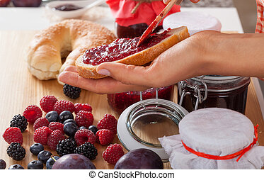 Berries and bread with jam