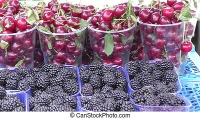 Berries and fruits sold in the Bazaar - Fresh berries and...