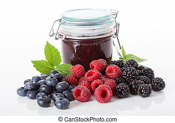 Berries for a jam - Fresh berries and jar of a homemade jam