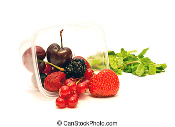 berries in a plastic box on a white background