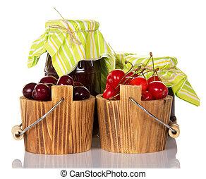 Berries in wooden buckets and jam
