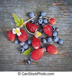 Berries on rustic wood background