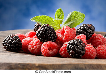 Berries on wooden table - photo of delicious berries with...