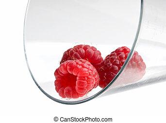 berries raspberries in a wineglass