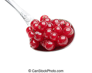 berries red currants in spoon isolated on a white background