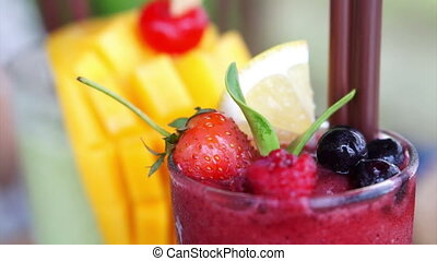 Berries smoothies mango tropical - Berries smoothies and...