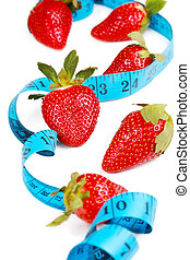 Berries with tape measure. Health concept.