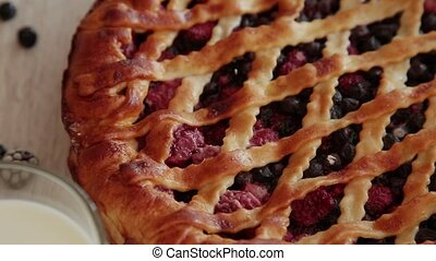 Berry cake made by own hands on a wooden background. - Berry...