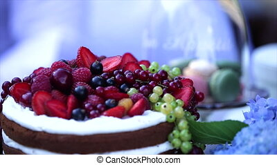 berry cake sprinkled with icing white table.
