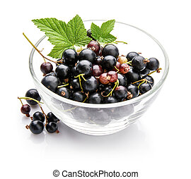 Berry currant in glass dish with green