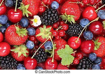 Berry fruits background with strawberries, blueberries, red currants, cherries, raspberries and blackberries