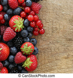 Berry fruits like strawberries, blueberries, red currants,...