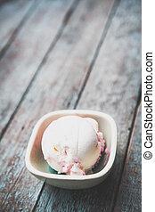 Berry ice cream on wood background
