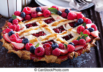 Whole assorted berry lattice pie with raspberry and cherry
