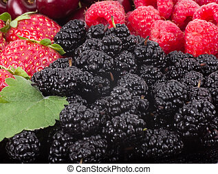Berry Mix background - mulberry, raspberries and strawberry