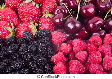 Berry Mix background - raspberries, mulberry, strawberry and...