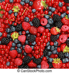 Berry Mix - On a table are lying strawberries, bilberries, ...