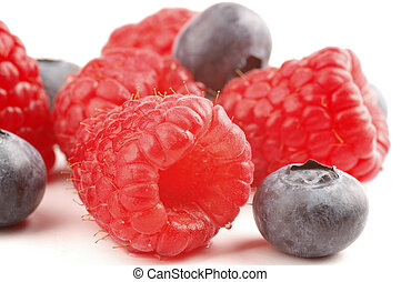 Berry Mix - Ripe raspberries and blueberries on a white ...