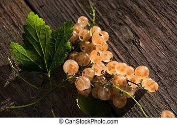 berry of white currant on a wooden