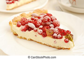 Berry pie with whipped cream filling close up