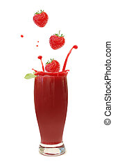 Strawberries splashing into a blended smoothie drink
