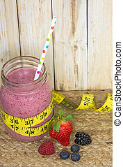berry smoothie with tape measure