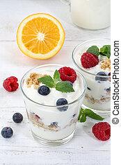 Berry yogurt yoghurt with berries fruits cup muesli portrait format breakfast
