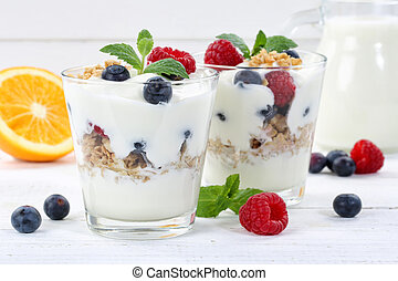 Berry yogurt yoghurt with berries fruits cup muesli wooden board breakfast