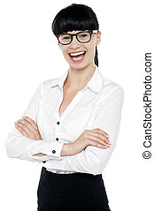 Bespectacled happy woman posing casually