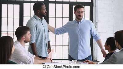 Best african male employee get rewarded at team meeting