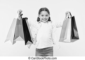 Best discounts and promo codes. Back to school season great time to teach budgeting basics children. Girl carries shopping bags. Prepare for school season buy supplies stationery clothes in advance