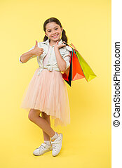 Best discounts and promo codes. Girl carries shopping bags. Back to school season great time to teach budgeting basics children. Prepare for school season buy supplies stationery clothes in advance