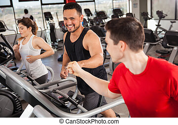 Best friends doing cardio in a gym