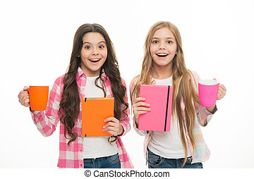 best friends. Girls hold cup of tea and book. Literature for kids. happy children isolated on white. sisterhood concept. childhood happiness. fun time at school. Girlish bestseller book. nice story