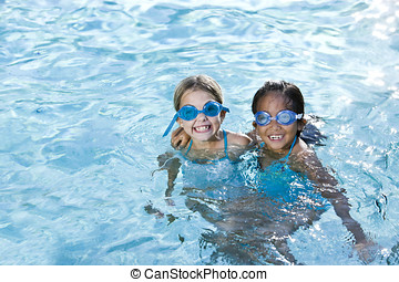Best friends, girls smiling in swimming pool - Two girls, 7...