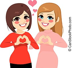 Best Friends Heart - Two best friends girls smiling showing...