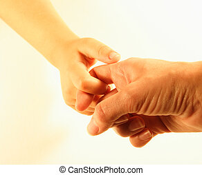 Mother and child's hands with linked fingers. White background.