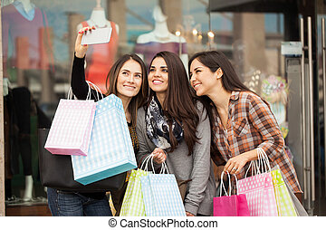 Best friends shopping and taking a selfie