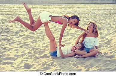 Best friends teen girls fun in a beach sunset - Best friends...