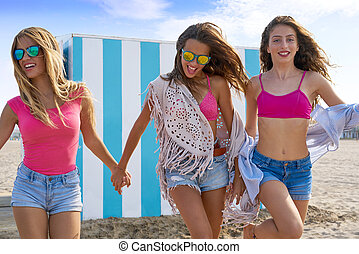 Best friends teen girls running happy in beach - Best...