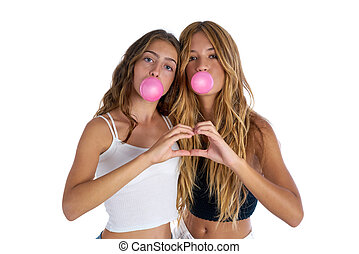 Best friends teen girls with bubble gum and heart fingers...