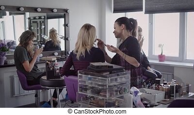 Best friends together came to a beauty salon to make a...