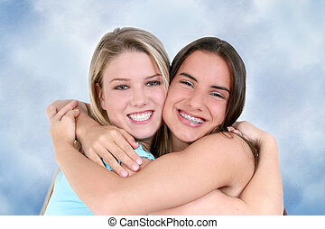 Two teen girls smiling and hugging. Shot with the Canon 20D.