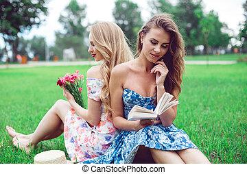 Best friends women having fun in park.