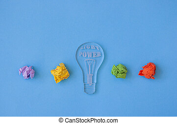best idea concept with crumpled colorful paper and light bulb