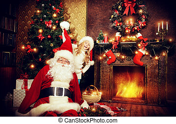 best meeting - Happy little girl sitting with Santa Claus...