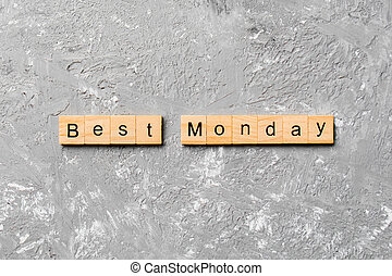 best monday word written on wood block. best monday text on cement table for your desing, concept